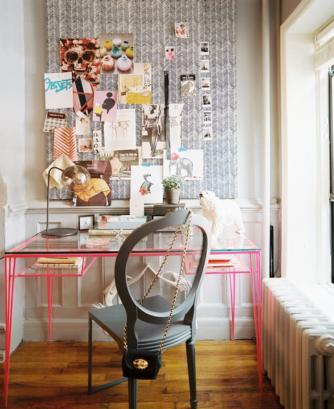 Work Space - A pink desk paired with a gray chair