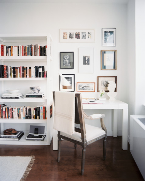 Work Space - A white Parsons desk beside a white bookcase