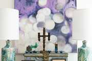 Artwork by Chicago artist Linc Thelen work with a Mexican hand-carved vintage candelabra, a late 19th-century hand-painted, marbled metal box, midcentury volcanic turquoise lamps, and a large collection of Joanne Trestrail pottery