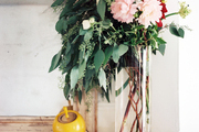 A vase of flowers atop a marble mantel