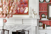 A traditional dining room with a marble hearth, chandelier and painted built-in bookcases, designed by BHDM