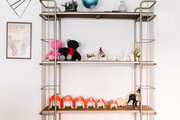 A cool shelving unit with kids toys on it.