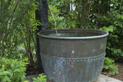 A fountain spilling into an antique chocolate vat