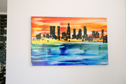 A multicolored painting of a city skyline.