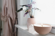 Stier brings nature's raw energy indoors, decorating her tiny bathroom space with assorted crystals and restorative candles. Go full zen and burn a scent designed specifically for even the smallest bathroom space.