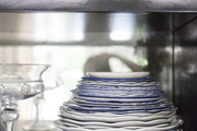 A collection of blue and white dishes and glasses