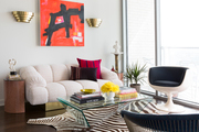 A contemporary living room with mid-century modern accents.