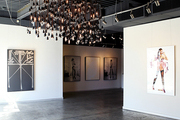 An array of pendant and track lighting in the industrial Guy Hepner art gallery in West Hollywood