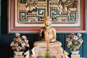A tablescape built around a gold Buddha