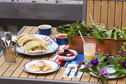 An eclectic menu of tacos and fried chicken on a festive outdoor table to celebrate Cinco de Mayo and the Kentucky Derby