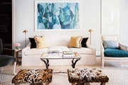 A neutral living space with accents of blue and leopard print