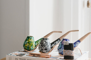 """We felt like the best way to break the stigma was to make products that people actually want to show off and display in their homes,"" adds Dineen. ""Things that could bring consumption out of the shadows."" Cannabis entrepreneur Hayley Dineen decorates her home with her own intricately hand-painted wooden pipes."