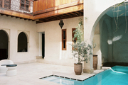 Moroccan architecture surrounding a pool