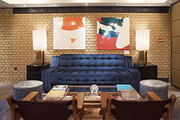 Overscale lamps and a velvet sofa in the lounge of Belgraves Hotel, designed by Tara Bernerd & Partners