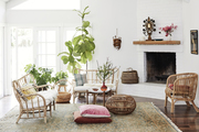 A bohemian living space with rattan furniture.