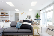 A contemporary living space with a gray sectional.
