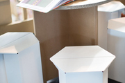 A cardboard table with white cardboard stools.