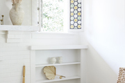 White shelves with urban furniture pieces.