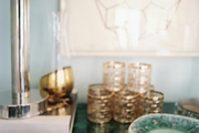 A malachite console topped with dishes and accessories
