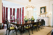 Chippendale dining chairs and pink curtains in a formal dining space