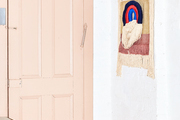 A pink door with white walls.