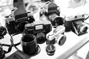 A collection of cameras on a table