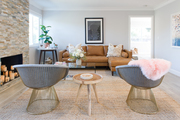 A contemporary living room with mid-century modern chairs.