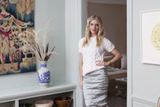 Designer Michelle Smith in a doorway of her Sag Harbor dining room