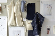 Fabric swatches and inspirational images pinned to a bulletin board