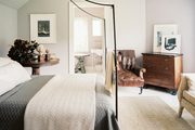 A delicate iron canopy bed in a guest room