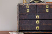 Vintage treasures collected on a wooden bureau
