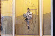 A window banner depicting Francis Bacon's triptych of Lucian Freud, which recently sold for a record-setting $142.4 million.
