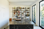 Here is a kitchen island with a bookcase behind it.