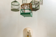 A chandelier composed of repurposed birdcages