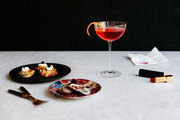A Campari-Lillet cocktail paired with pomegranate-garnished oysters and cauliflower fritters