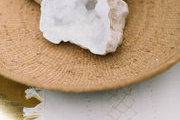 A detail of some white geodes on a woven tray.