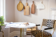 A small contemporary dining area with glam leopard print chairs.