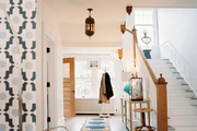 A wide hallway with a blue patterned rug