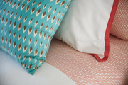 Patterned linen and vibrant throw pillows.