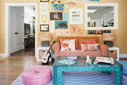 A gallery wall of art and kids' creations in a pattern-filled family room