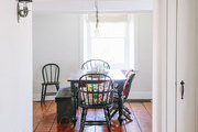 Spindle-back chairs in a rustic dining room