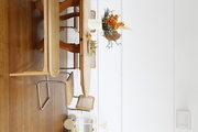A vintage table and chairs in a white dining room.