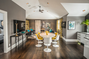 Contemporary gray, white, and yellow dining area.