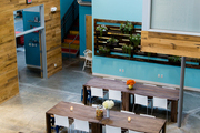 An open floor plan and communal tables at Jessica Alba's Honest Company office
