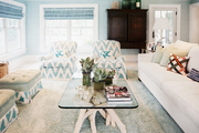A pair of chevron armchairs in a blue-and-white living room