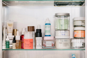 Beauty products stored in a bathroom cabinet.