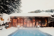 A pool surrounded by snow-covered trees