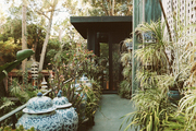 Ginger jars and potted plants lining a pathway