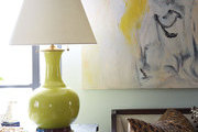 A side table with chartreuse lamp in Emily Beare's apartment.