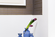 A trio of blue vases in a bathroom